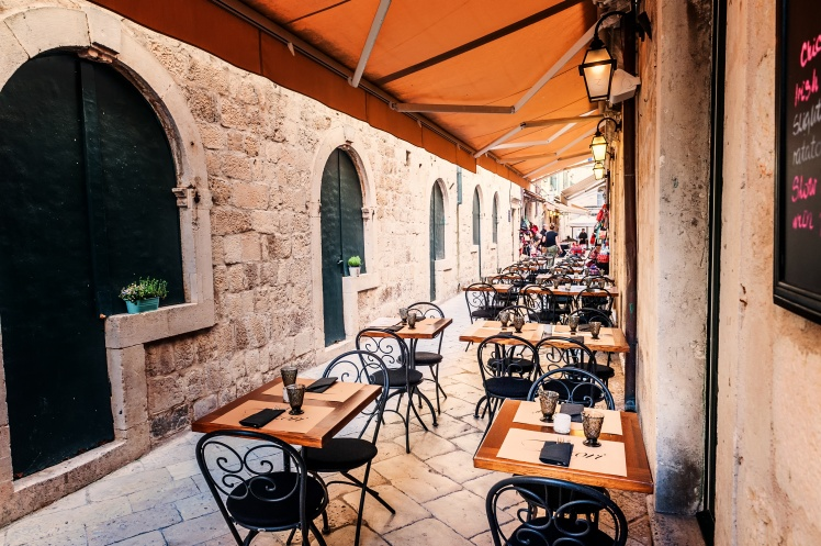DUBROVNIK, CROATIA - APRIL 10: Restaurant terrace in the old town of Dubrovnik, in the narrow streets, are ready for tourists from all over the world on April 10, 2015.